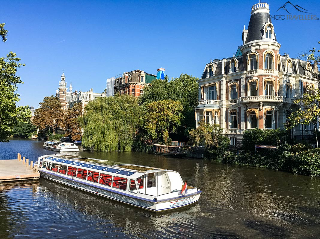 A tour boat on a canal in Amsterdam